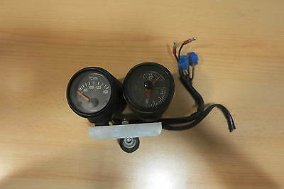 BMW moto guzzi time clock and temperature gauge.