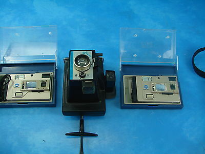 Set of 2 Minolta Disc-7 Cameras and Polaroid Land Camera Super Shooter
