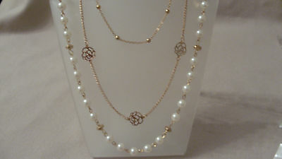 3 chain long necklace with pearl and flower detail in gold