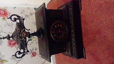 A vintage brass and slate large mantle clock