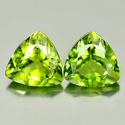 A PAIR OF 5mm TRILLIANT-FACET STRONG-GREEN NATURAL AFGHAN PERIDOT GEMSTONES