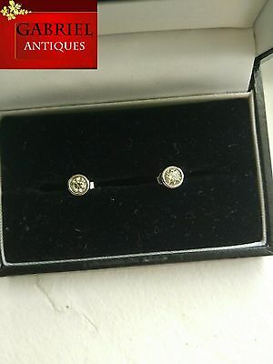 A pair 18ct white gold 1ct,diamond stud earrings