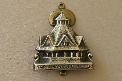Vintage brass door knocker featuring Dunster Yarn Market