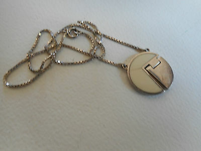 Vintage sterling silver pendant with white insert movable parts and chain