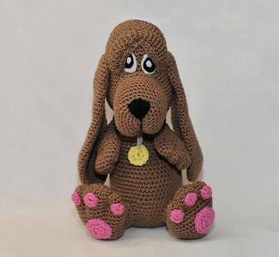 A gorgeous, hand crocheted Basset Hound dog with his smart collar and pink paws