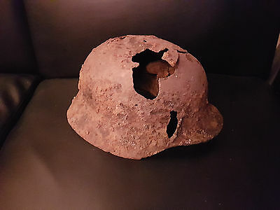 Original WW2 German Helmet in relic condition. Battle damaged