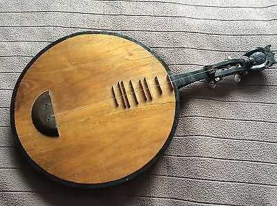 Modified Chinese moon guitar with carved bat, in need of restoration and tlc