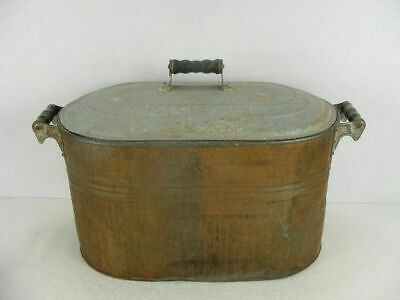 Antique copper boiler with wood handles