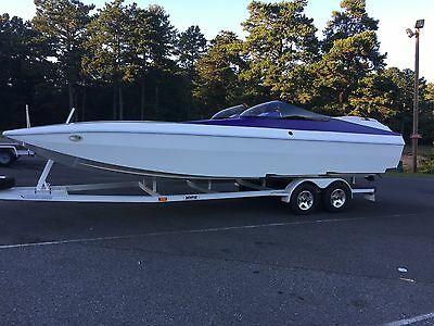 2005 Warhawk 27' tunnel hull/ cat 108 MPH Mercury Racing