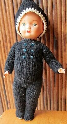 """9"""" tall Celluloid doll dressed in black crochet outfit"""