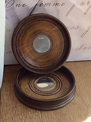 """A pair of large solid silver and turned wood wine bottle coasters 5.75"""" diam"""