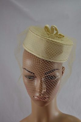 VINTAGE 1970s ivory polyester pillbox hat with mesh veil