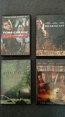 4 DVDS movies Mission Impossible 3, Pirates of Caribbean - Black Pearl, Seabisc