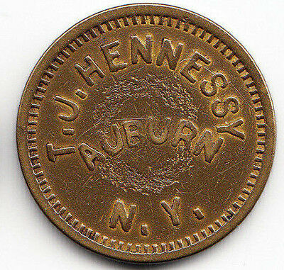 Auburn N.Y. token - T.J.Hennessy - 5c in trade - Cayuga County New York