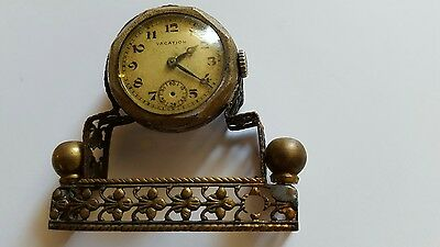 Rare miniature clock named VACATION not working,spares and repairs.