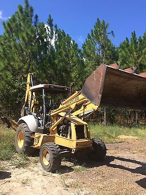 1990 Ford backhoe, 4 Wheel Drive, 912-293-7535
