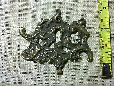 French Rocco cast brass escutcheon, antique or vintage