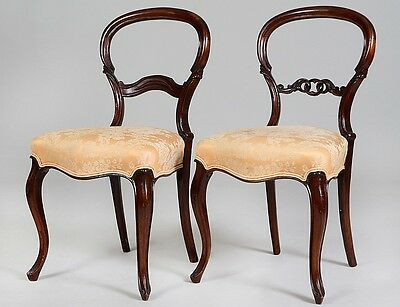 TWO SIMILAR VICTORIAN WALNUT SIDE CHAIRS Lot 308
