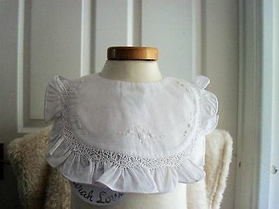 baby girl frilly bib in poly/cotton by Sarah Louise £5.50