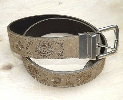 "Women's genuine leather belt. Tan with embroidered design. 34"" length."