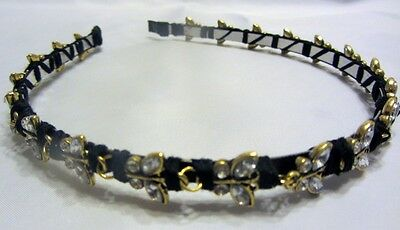 A hand-made ladies headband made of gold and crystal butterfly beads