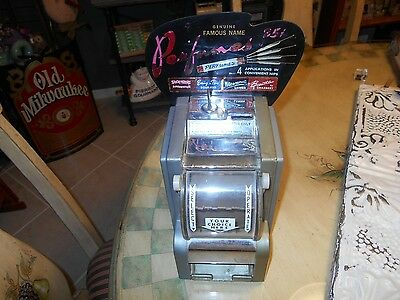 25 Cent Perfume Dispenser With Marque