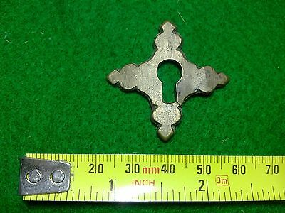 bronze or brass escutcheon, some damage, keyhole, antique