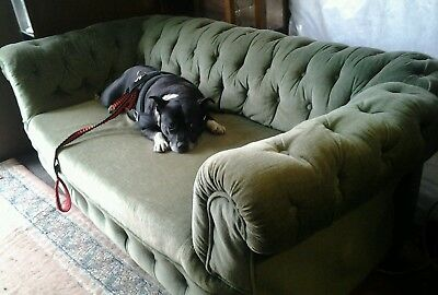 Chesterfield two-seater antique green velvet drop-end sofa.