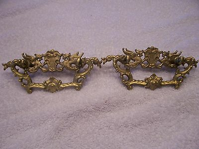 Antique brass drawer pulls with winged horses or griffins matched pair