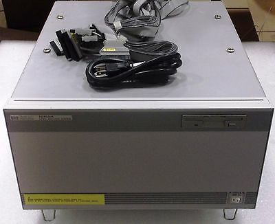 Agilent 16700A Logic Analysis System With (2) 16717A Modules And POD Cables
