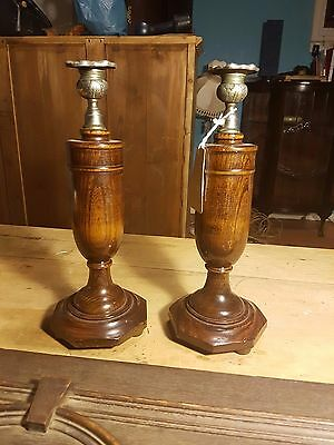 A pair of Antique Oak Candle Holder