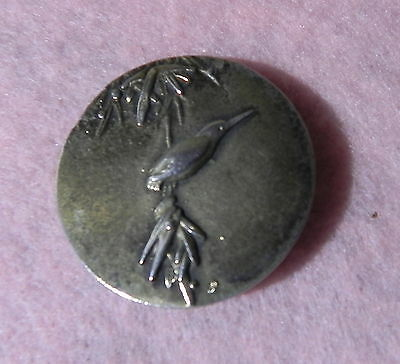 VINTAGE BUTTON MARKED STERLING PICTURING LONG BEAKED BIRD ON TREE - 1 & 1/4 in.