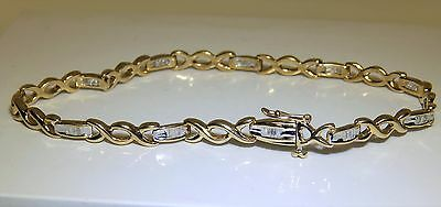 A FINE 9CT YELLOW  GOLD 0.15CT  BAGUETTE DIAMOND KISS LINK TENNIS  BRACELET 7.3g
