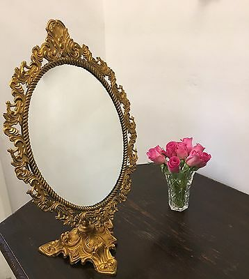 Original Italian Baroque Cheval Pedestal Brass Mirror in Antique Gold.