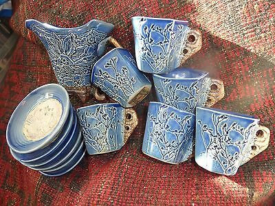 Malaysia Handicraft, Tenmoku Pottery Six Blue Cups/saucers  With Moulded Pattern