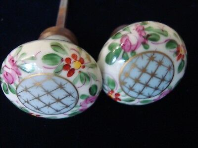 A Pair Of Antique Painted Door Knobs.