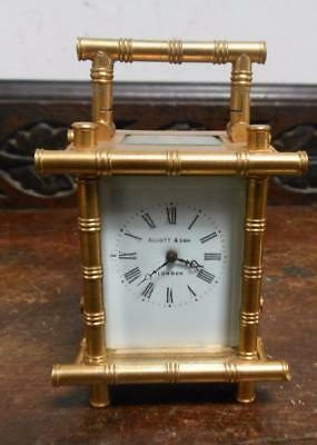 small brass cased carriage clock bamboo style