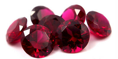 A PAIR OF 5mm ROUND-FACET TOP-RED LAB RUBY GEMSTONES