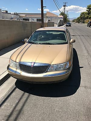 1999 Lincoln Continental  Lincoln Continental 1999  75000 miles Gold