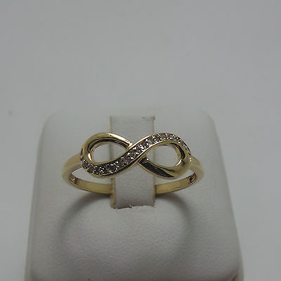 9ct YELLOW GOLD DIAMOND INFINITY RING - RING SIZE P 3/4