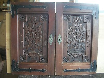 Great salvaged Victorian walnut cabinet doors, carved panels, strap hinges