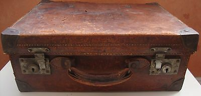 1920-30 old leather suitcase with a four lever lock