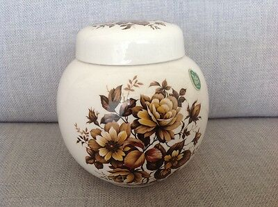 "Vintage Melba Ware "" Ginger Jar "" decorated with lovely brown flowers."