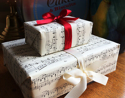 Music wrapping paper, warm cream colour.  Six  A3 size sheets