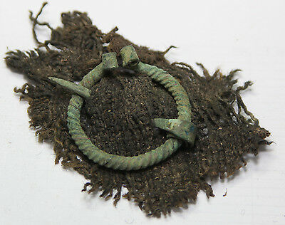 Ancient Viking  piece clothing with a bronze fibula . BIG SIZE