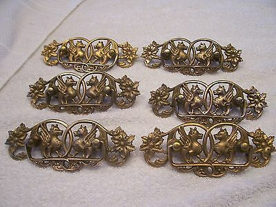 Antique brass drawer pulls with winged horses or griffins