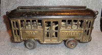 rare old painted cast iron street car trolley toy still bank