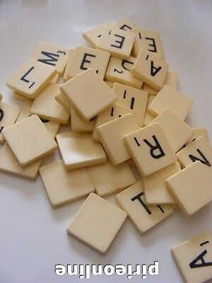 100 solid plastic scrabble tiles and 6 wooden letter racks