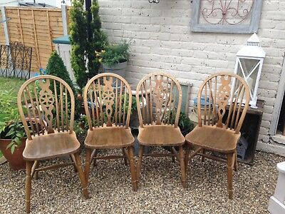4 Wheel back Vintage Chairs