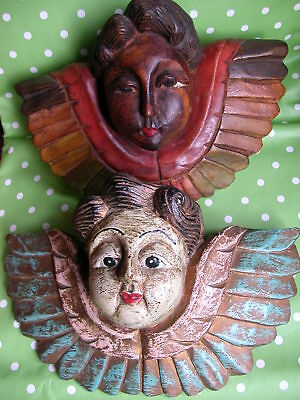 Two Folk Art Wall Mounted  Angel's Heads.  One Carved , One Moulded